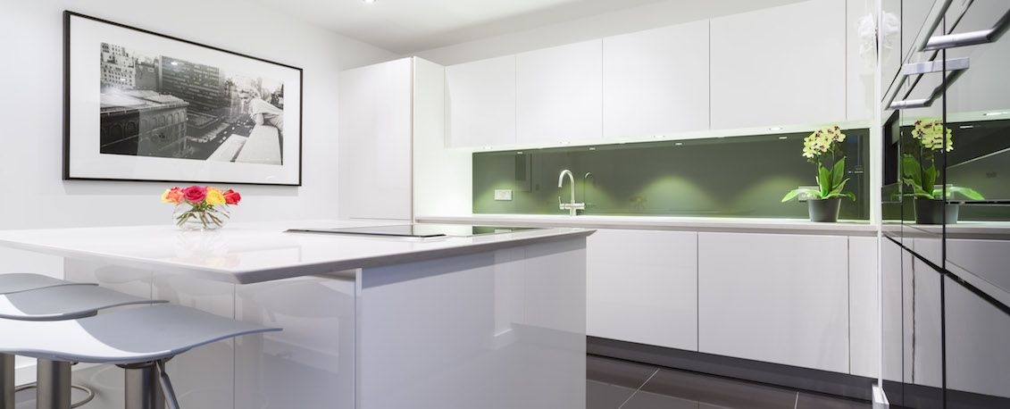 White Kitchen Island Design With Worktop Overhang To Create A Breakfast Bar  And Seating Area. The Handleless Style Is Idea For A Small Kitchen Island  Space, ...