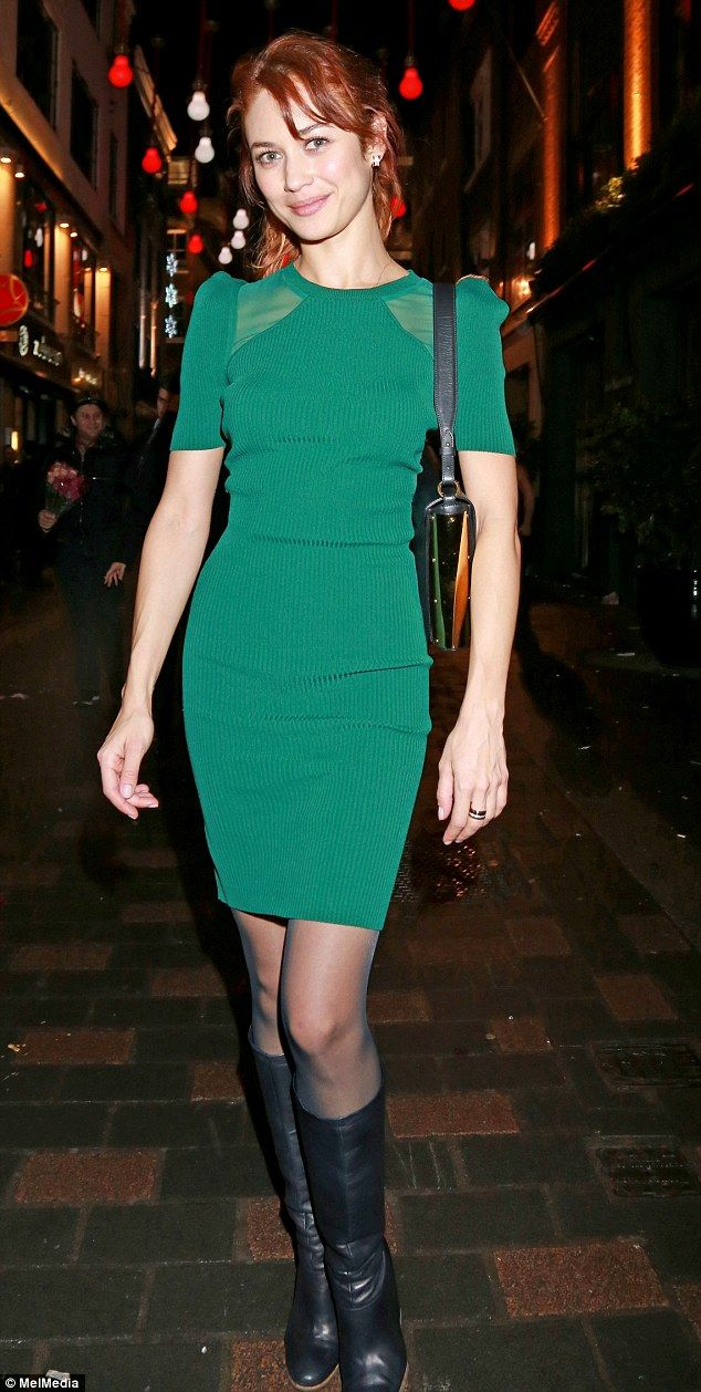 41e64518807 Olga Kurylenko pulled off a rather festive look as she teamed a jade green  dress with her dyed red hair in London on Friday evening