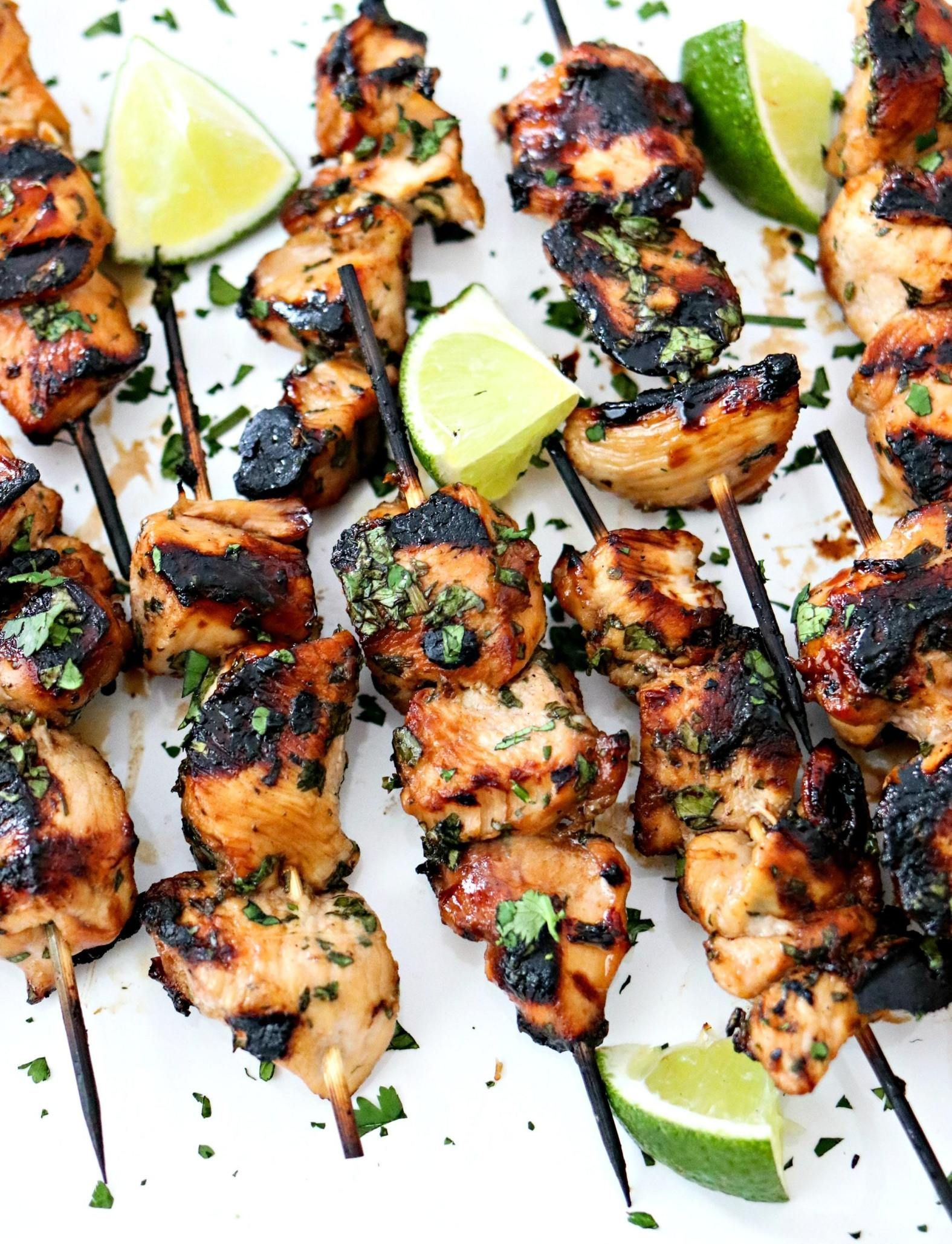 Grilled Cilantro Lime Chicken Skewers – This is the most tender and most flavorful chicken you will ever make! The chicken gets marinated in a honey, lime, cilantro, garlic, and soy sauce marinade for a few hours, skewered, and then grilled. Super easy and always a hit! Perfect for serving a crowd. #honeylimechicken Grilled Cilantro Lime Chicken Skewers – This is the most tender and most flavorful chicken you will ever make! The chicken gets marinated in a honey, lime, cilantro, garlic, and #honeylimechicken