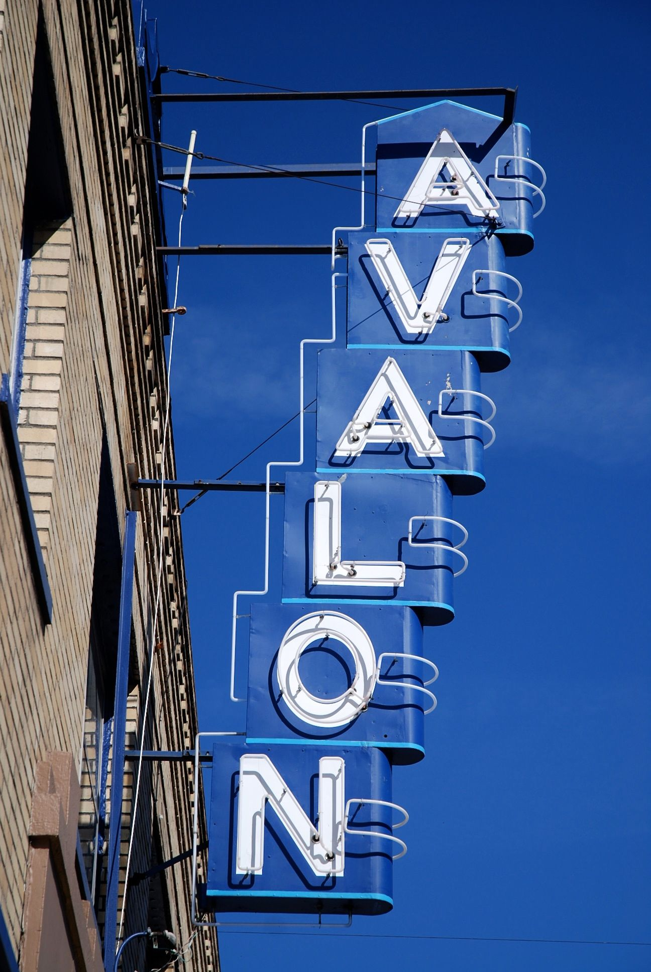 Avalon Theater neon sign. Three screens, nickel games, snack bar and videos. In operation since 1925. Hawthorne District. Portland, OR. Zippertravel.com Digital Edition
