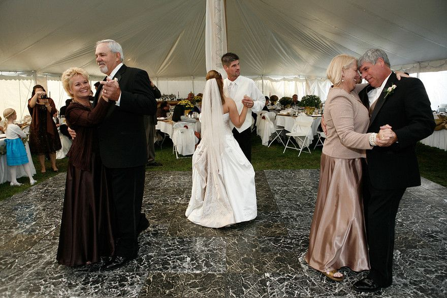 The Parents Dancing Along Side Their Children During Wedding Reception