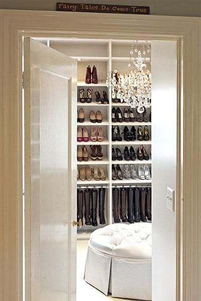 Dream chic gorgeous walk in closet design with gray silk skirted dream chic gorgeous walk in closet design with gray silk skirted tufted round ottoman crystal chandelier and shoe boot racks aloadofball Images