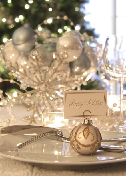 Gorgeous! White & gold Christmas table setting with an ornament as a place card holder.
