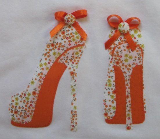 Con aplicaciones de patchwork en tonos naranjas esta for Aplicaciones para decorar