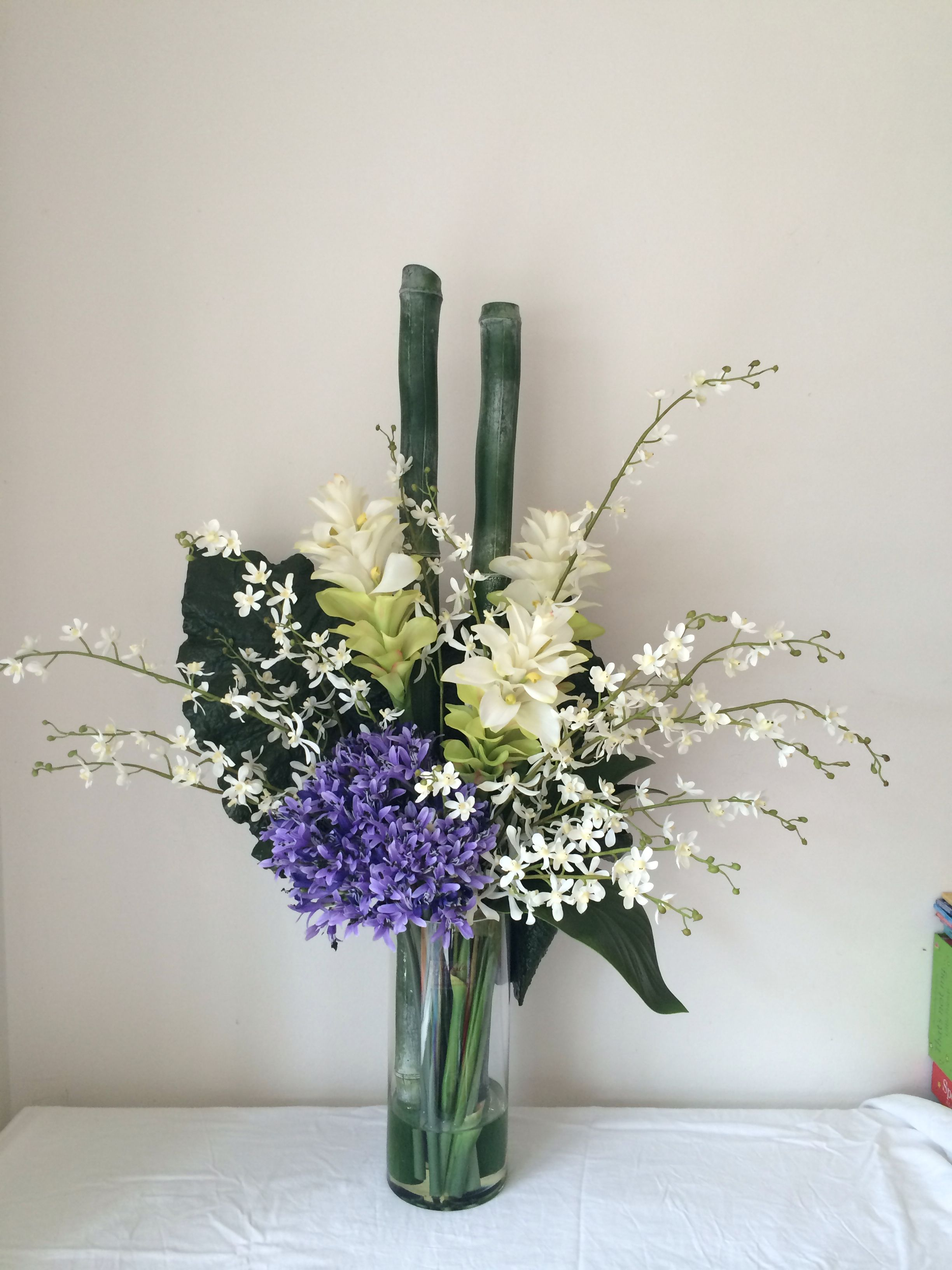 Large Tropical White Arrangement Of Bamboo Ginger Flowers Orchids And Agapanthus By Flora Corporate Flowers Artificial Flower Arrangements Flower Arrangements