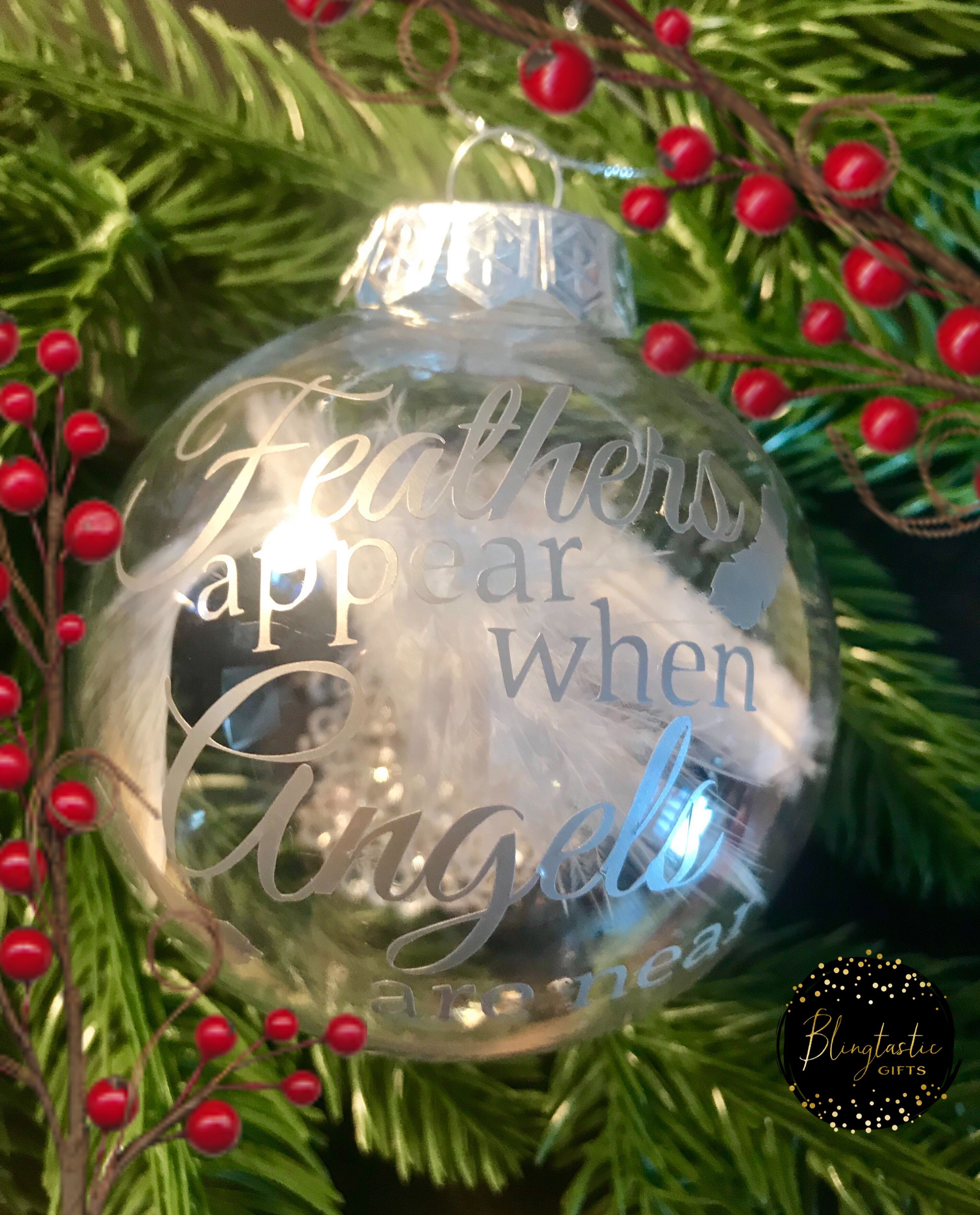 Large Clear Baubles Filled With A Pretty White Feather And Crystals