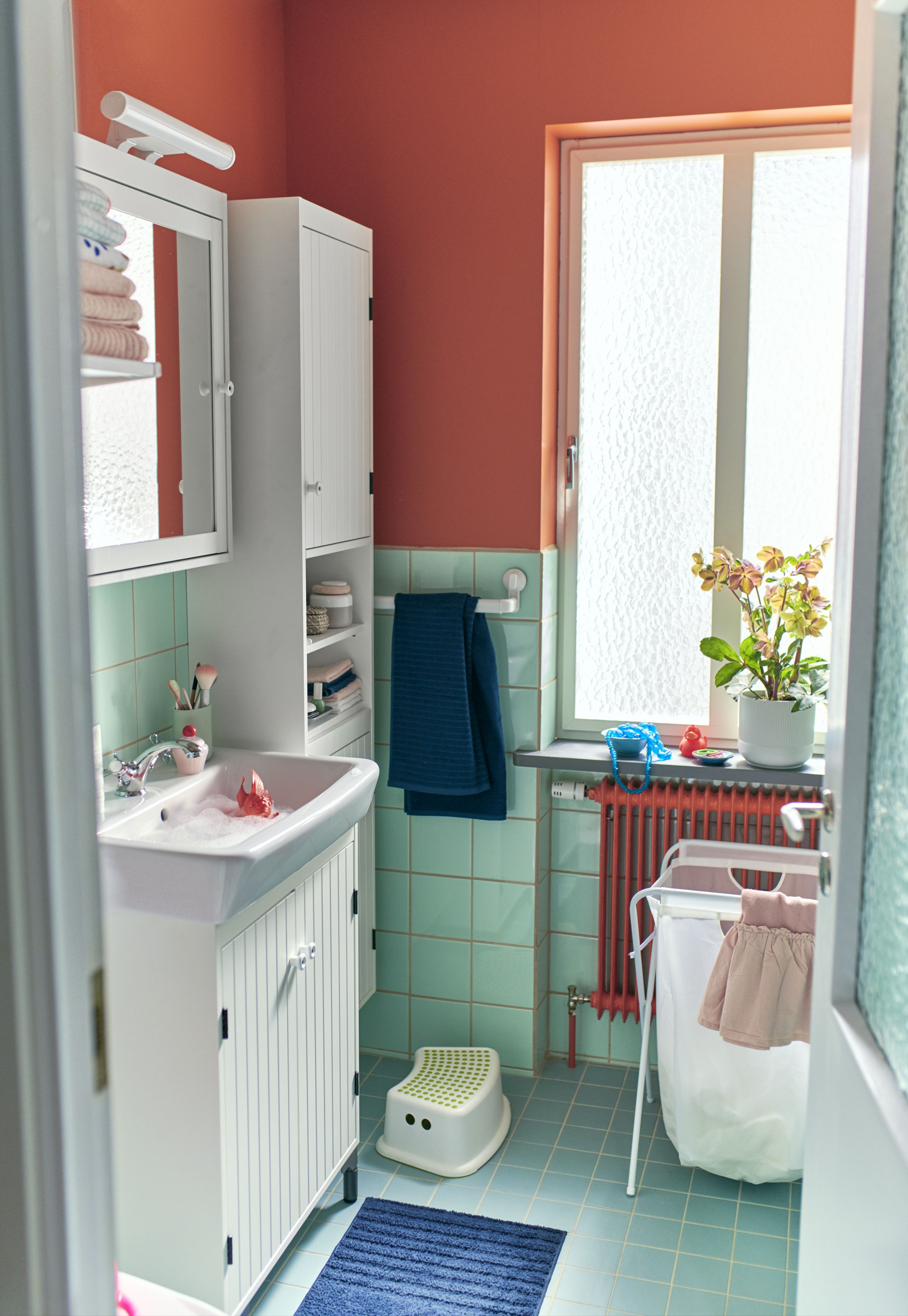 Maximize a small bathroom with both high and low storage