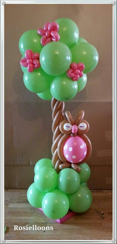 Small balloon column with owl also works as a table