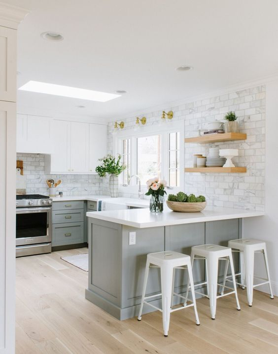 The kitchen white cabinet paint color is Benjamin Moore White Dove ...