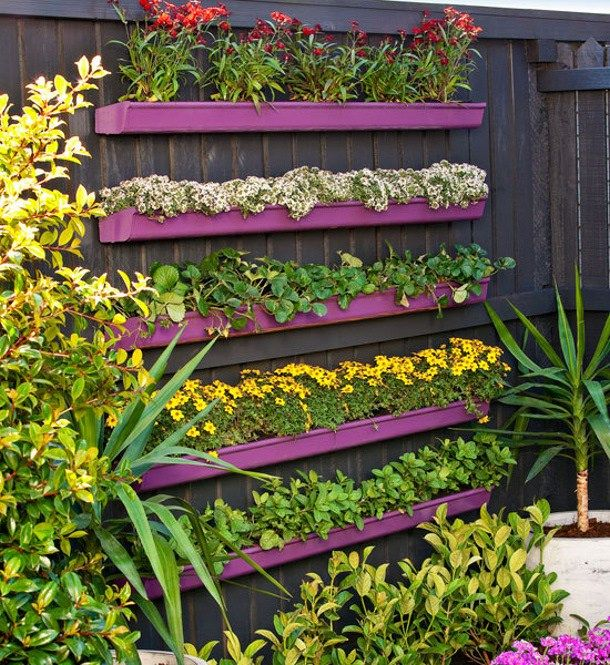 The best diy vertical gardens for small spaces garden planters diy projects how to build a do it yourself gutter vertical garden planter via bhg solutioingenieria Image collections