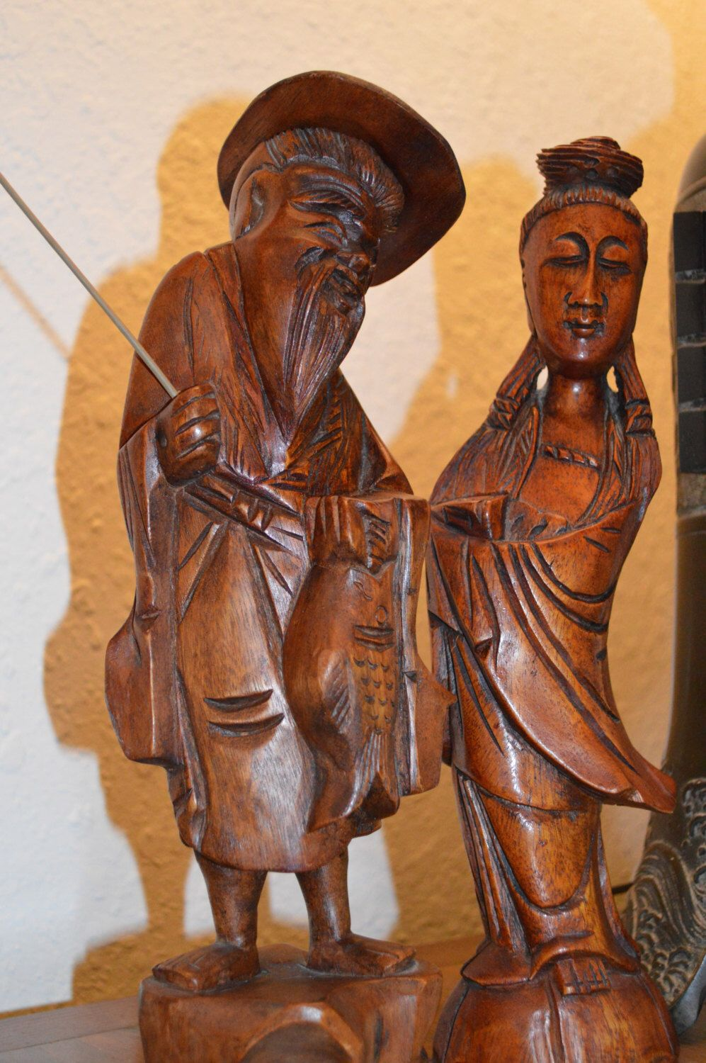 A personal favorite from my Etsy shop https://www.etsy.com/listing/204678963/vintage-hand-carved-wood-asian-fisherman