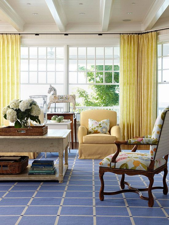 Long yellow drapes on a continuous curtain rod.