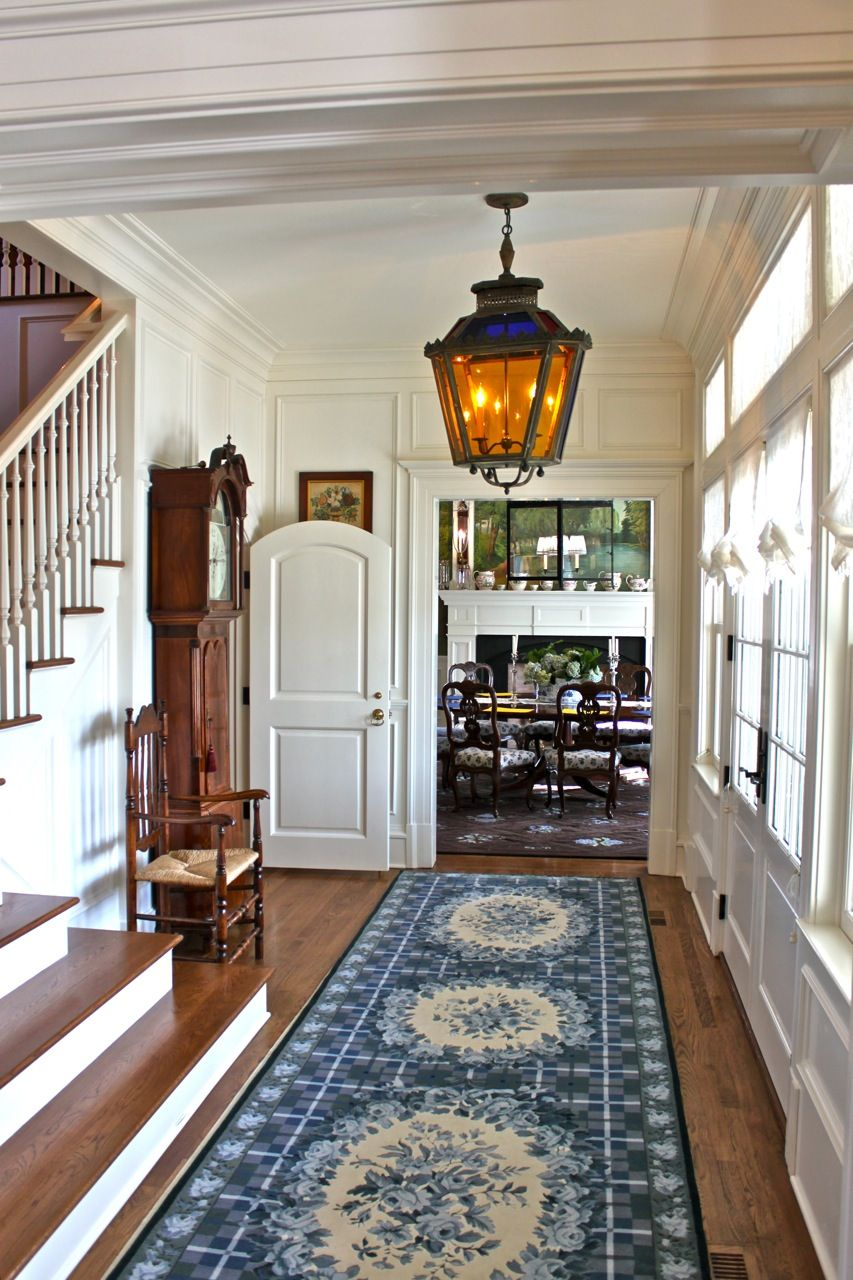Entry hallway lighting  Front hall toward dining room in Diamond Baratta designed house via