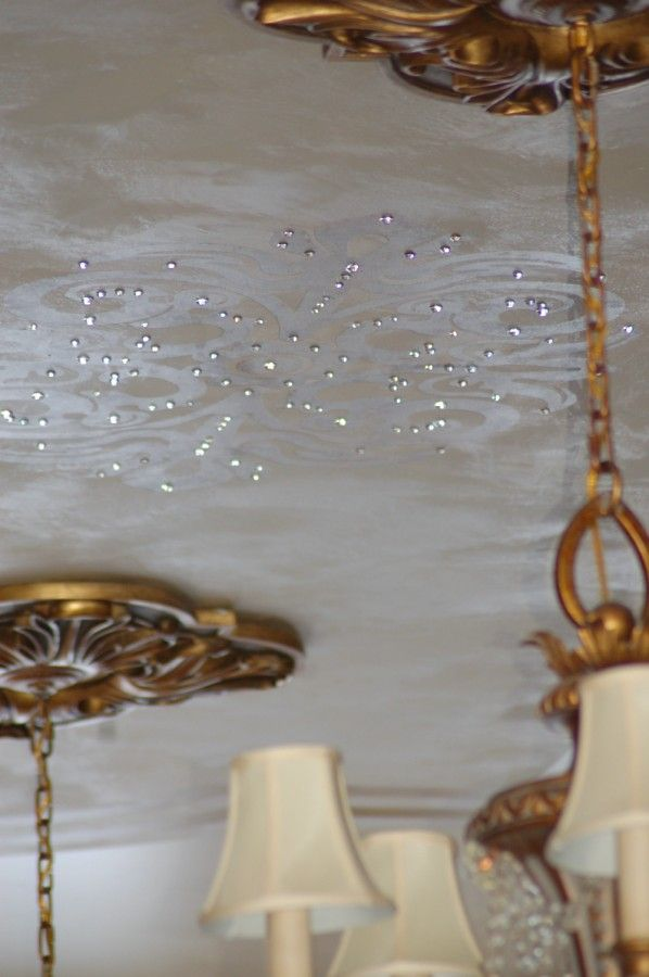 Swarovski crystals further enhance the delicate silver ceiling design.