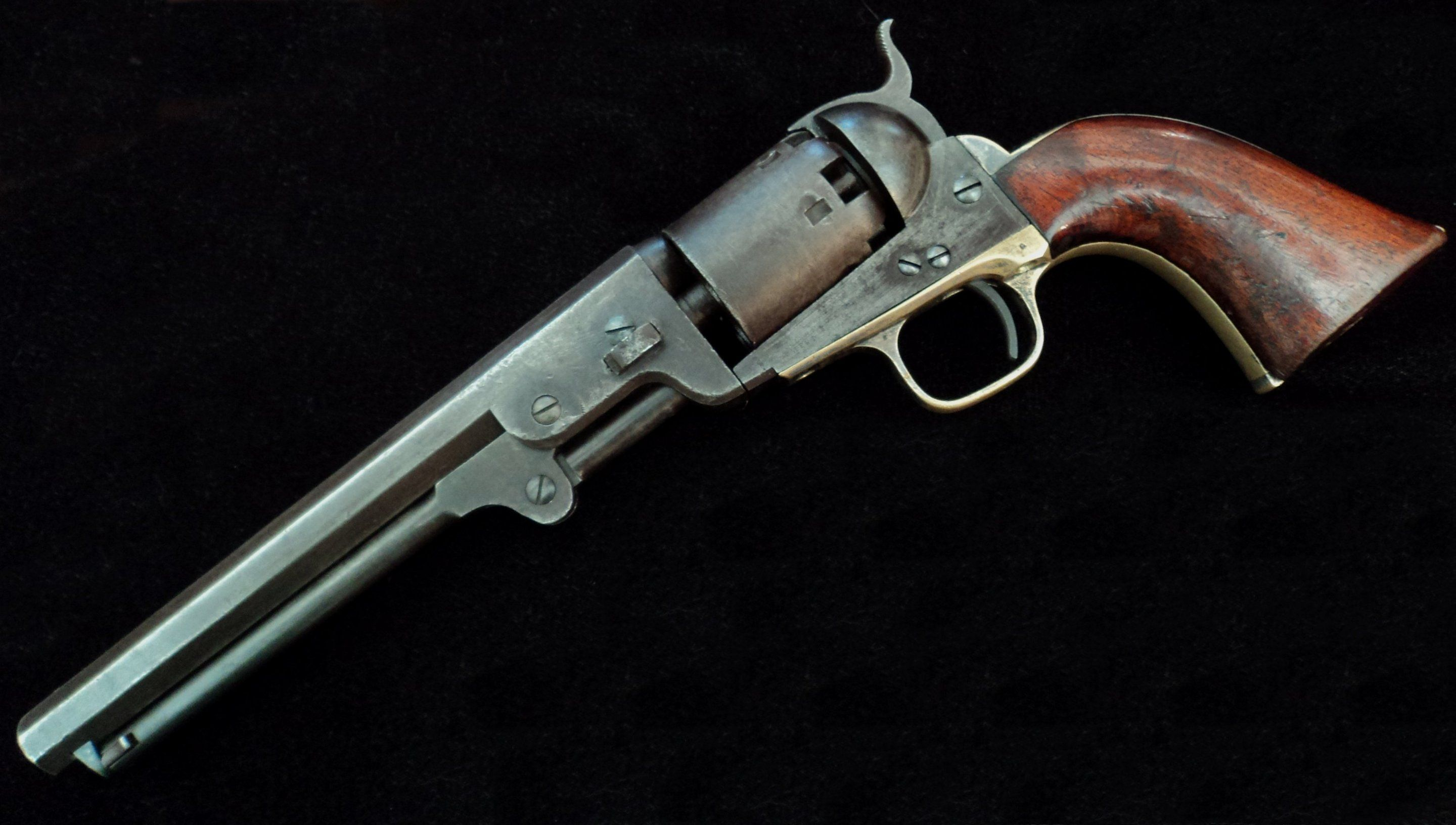 """The Colt Navy revolver serial number 94814, shown here, is marked """"C. L. Dragoons.""""  This is a very rare marking and one of the most remarkable weapons of the Confederacy.purchase 600 Colt revolvers for the State of Alabama, which the Governor used to present each commissioned officer of the early Alabama companies.  Four officers with the Crocheron Light Dragoons were presented a Colt Navy by the Governor of Alabama."""