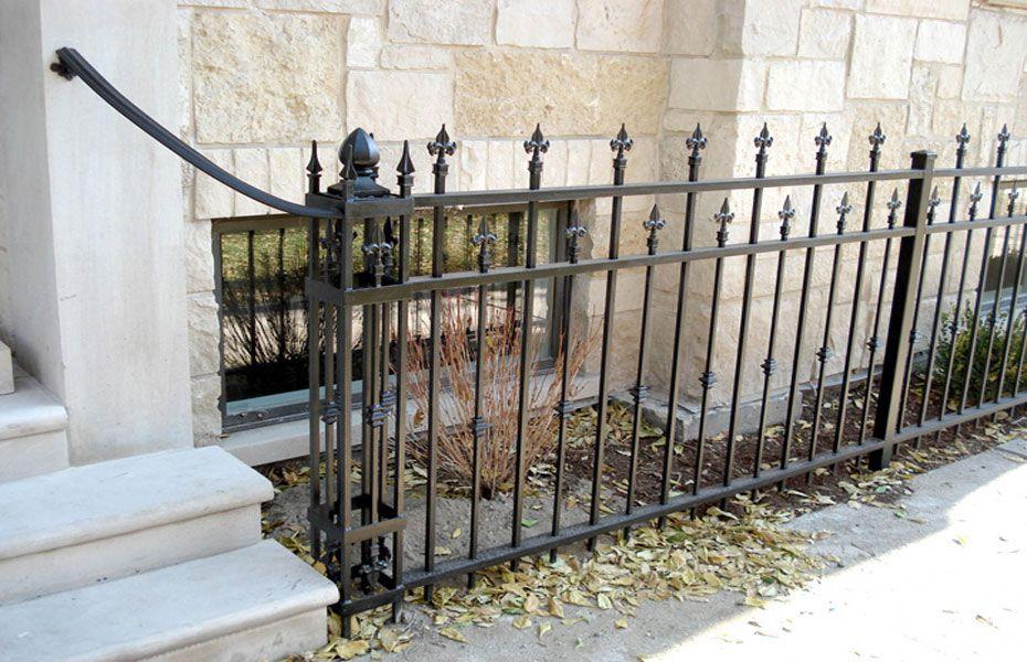 A Custom Budded Fleur De Lis Finial Wrought Iron Fence