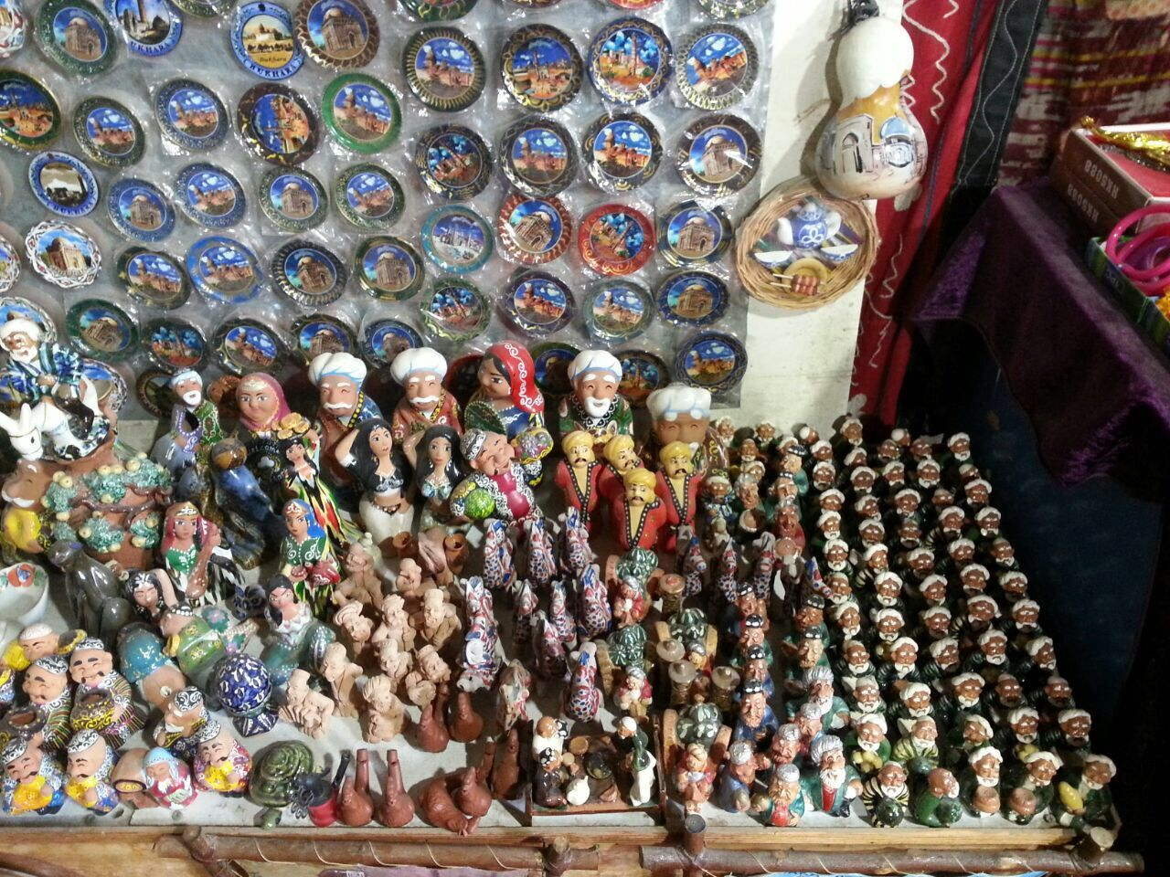Traditional ceramic babaychiki (small figures) reflect the peculiarities of culture and life of Uzbekistan