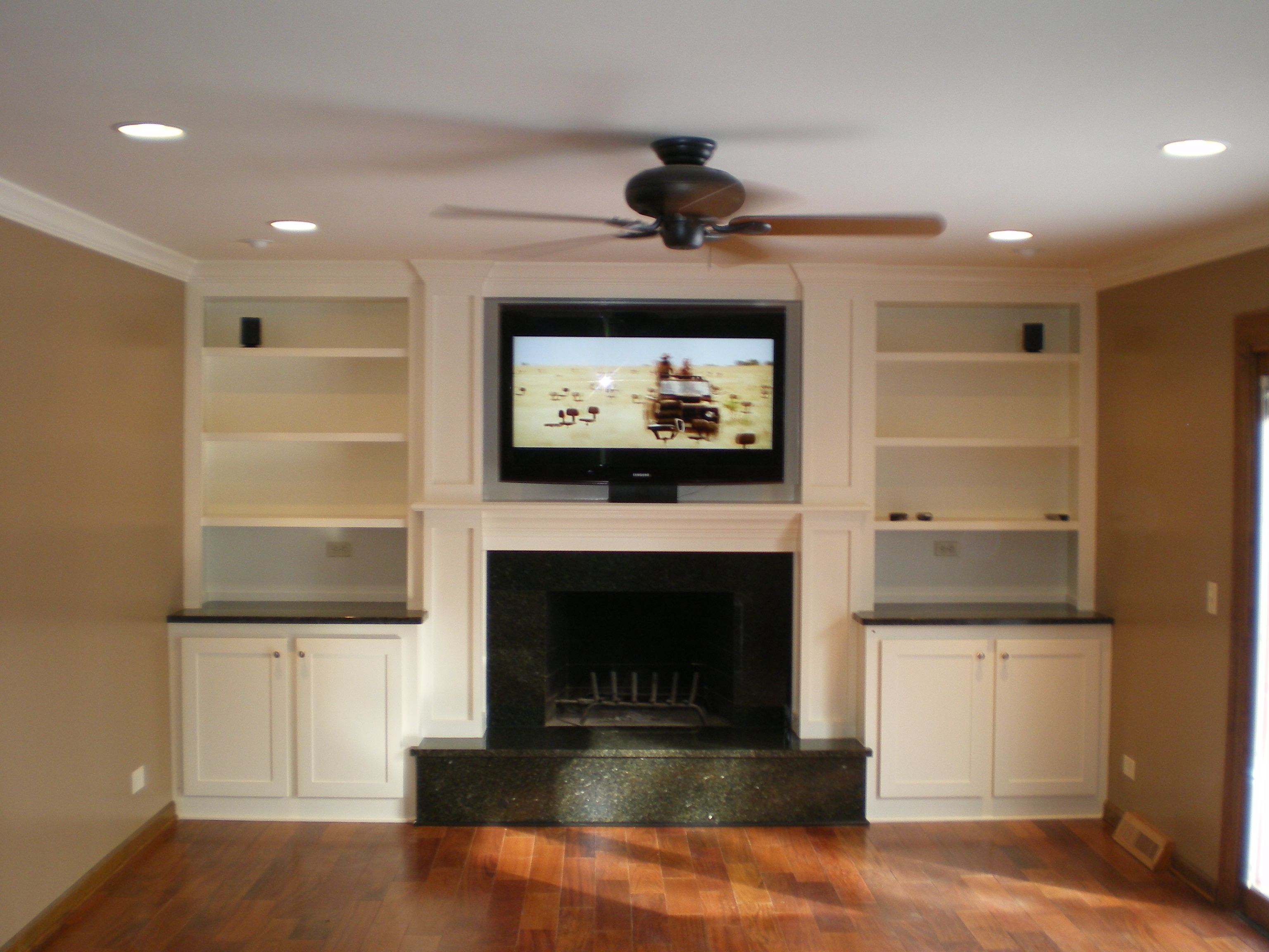 Tv Above Electric Fireplace With Bookshelves Rick Electrical Contractors Inc Project