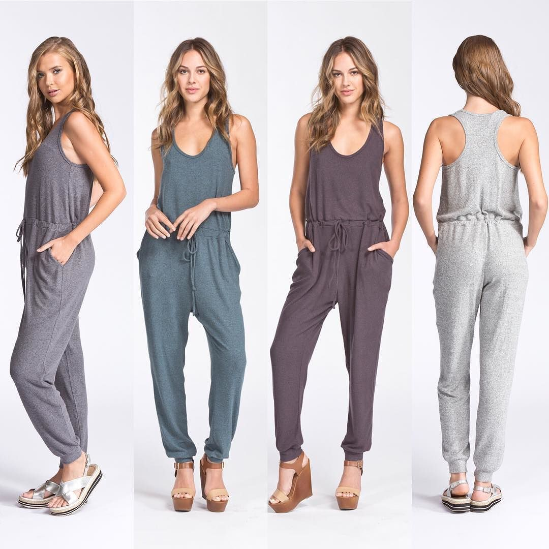 6ce37abf20c D6423 Loose fit scoop round neck sleeveless jumpsuit. Has tie at waist. Has  pockets at sides. This jumpsuit is made with a medium weight brush knit  fabric ...