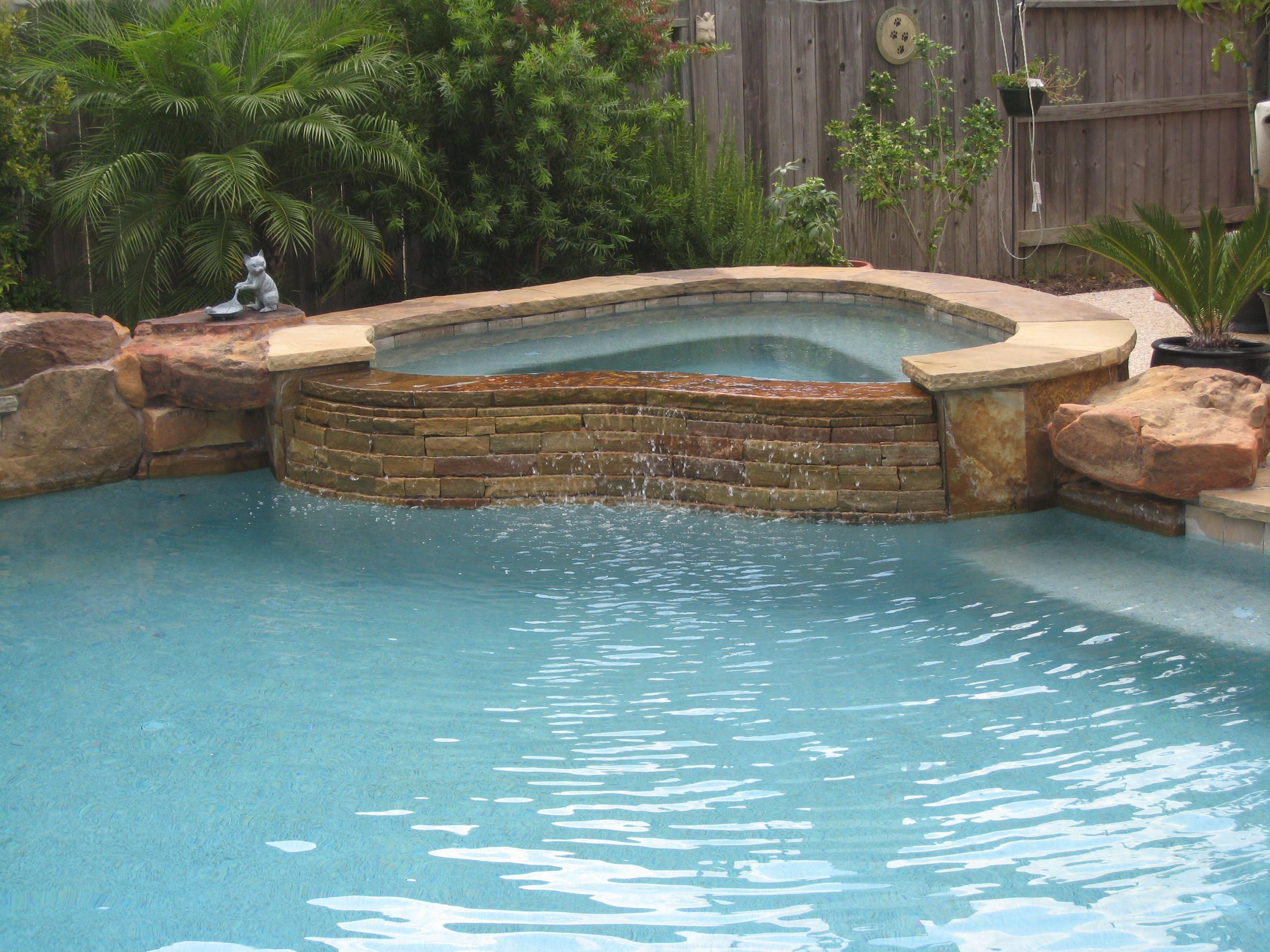 Stacked stone water feature - Custom Spa With Stacked Stone Spillway