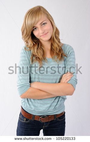 Smiling Girl With Crossed Arms Thirteen Year Old Girl