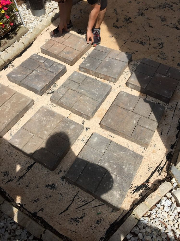 A husband and wife buy 18 paving stones at Home Depot for the best
