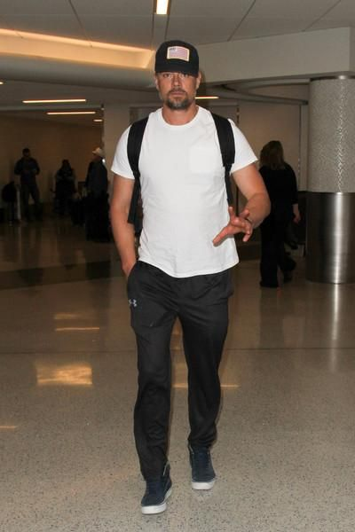 Josh Duhamel wearing Under Armour Ua Sportstyle Joggers and Vans Sk8-Hi  Reissue in Black