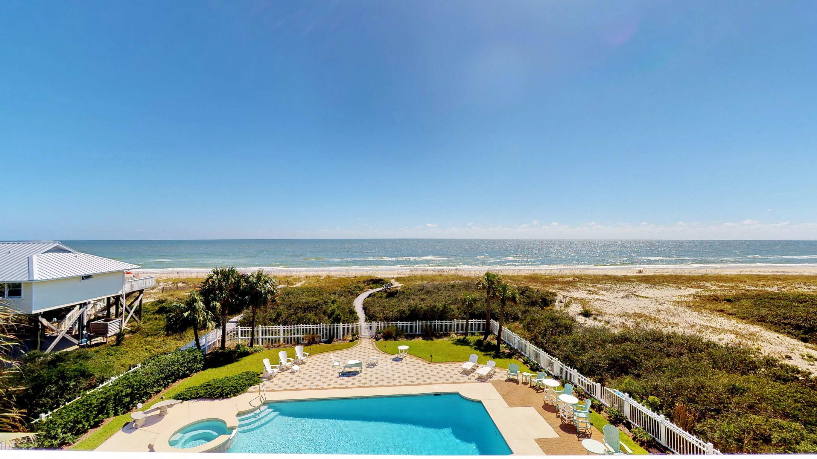 Aisle of palms beachfront swimming pool pet friendly