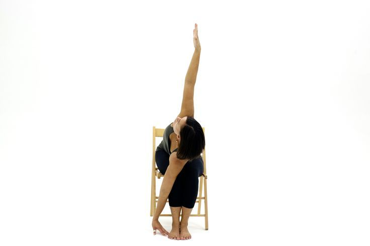 10 Yoga Poses You Can Do In A Chair Chair Yoga