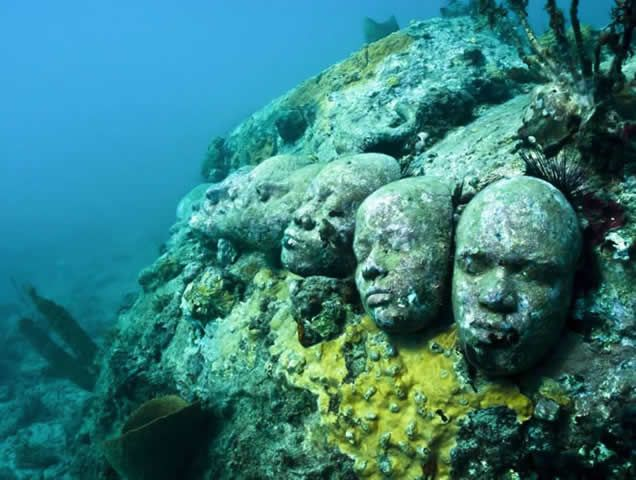 Grenada, West Indies - Jason deCaires Taylor is an internationally acclaimed eco-sculptor who creates underwater living sculptures, offering viewers mysterious, ephemeral encounters and fleeting glimmers of another world . His site-specific, permanent installations are designed to act as artificial reefs, attracting corals, increasing marine biomass & aggregating fish species, while crucially diverting tourists away from fragile natural reefs & thus providing space for natural rejuvenation.