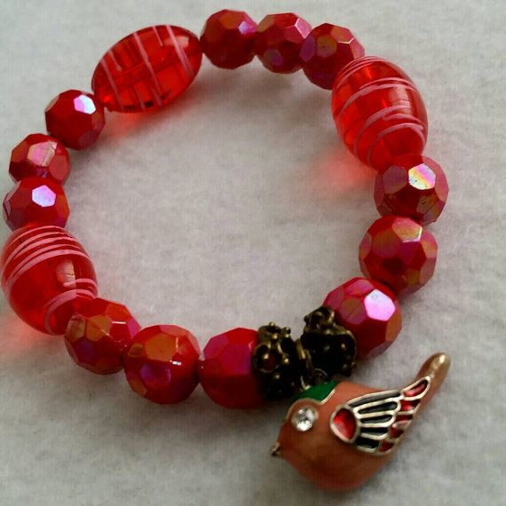 Hey, I found this really awesome Etsy listing at https://www.etsy.com/listing/228565229/womans-red-beaded-bird-charm-bracelet