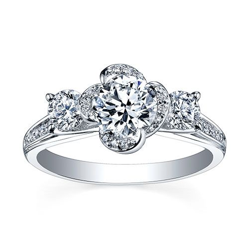 Floral inspired round brilliant cut three stone engagement ring