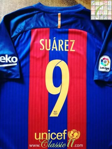 e97febbec88 Official Nike Barcelona home football shirt from the 2016 2017 season.  Complete with Suarez  9 on the back of the shirt and La Liga patch on the  sleeve.