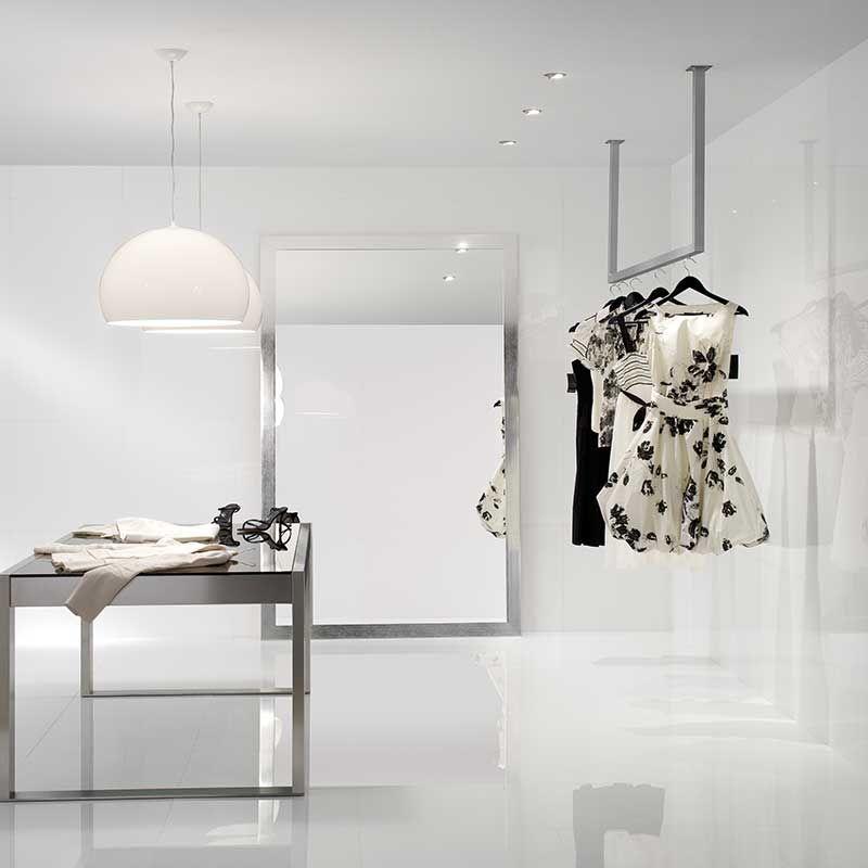 Pin By Roca Tile Usa On Tile White Porcelain Tile Living Room Decor Lights Concrete Floors Living Room