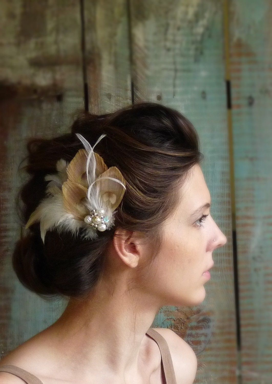 Peacock and ivory feather hair fascinator with a vintage crystal and
