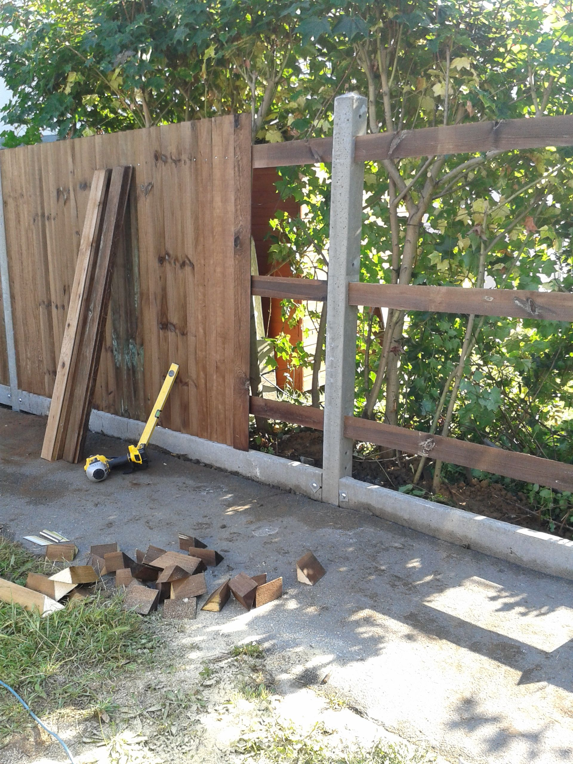 Construction Of Close Boarded Fence With Concrete Posts