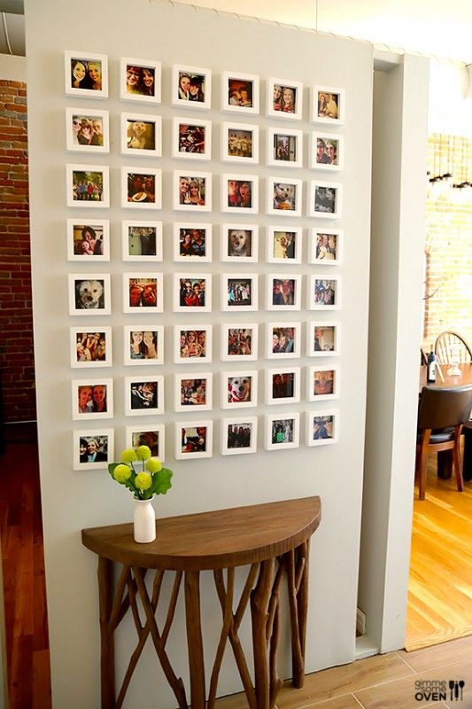 Instagram frame wall -- super cool half-circle branch console table, too! Gimme Some Oven