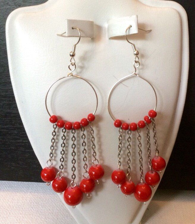 A personal favorite from my Etsy shop https://www.etsy.com/listing/245066527/red-cascade-earrings
