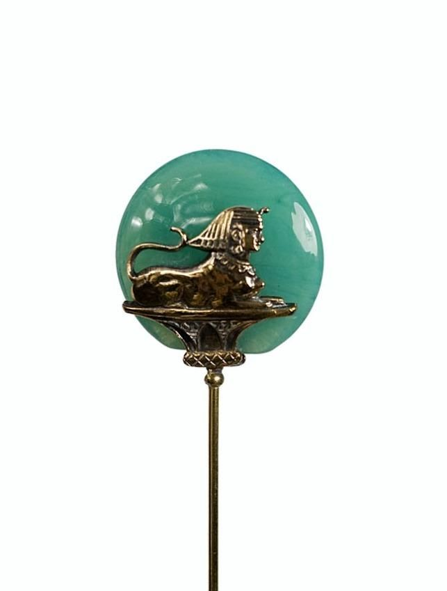 Antique stick hat pins like this one with the Sphinx on it exemplify the Egyptian Revival style which became popular in the early 20th century. This renewed interest in Egyptian antiquities began as a result of the opening of King Tut's Tomb in 1922.