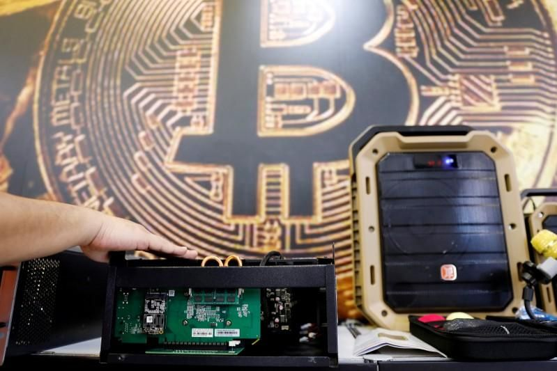 China leaves bitcoin mining out of list of restricted