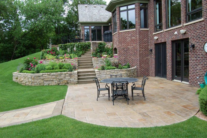 Stamped Concrete Patio With Stone Retaining Wall Concrete Patio Limestone Patio Patio