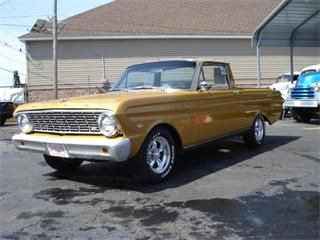 Cool looking Ford Ranchero, great wheels, not a stock color, still clean, B+