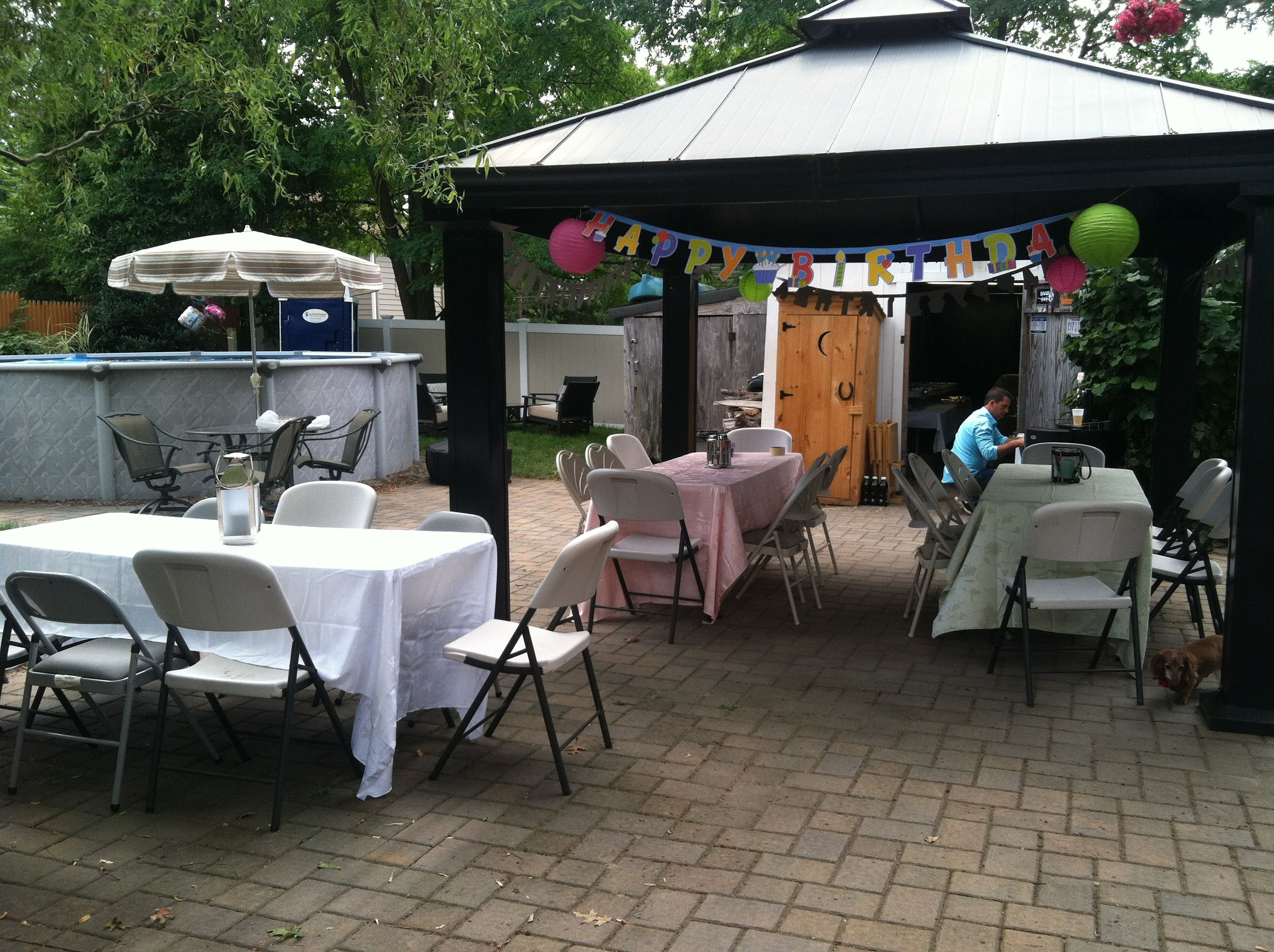 We also put tables on the patio. We decorated the tables the same as the ones on the lawn. Instead of using a single color of clothes; we used pink, green and white. The lanterns were all different colors, sizes and shapes.