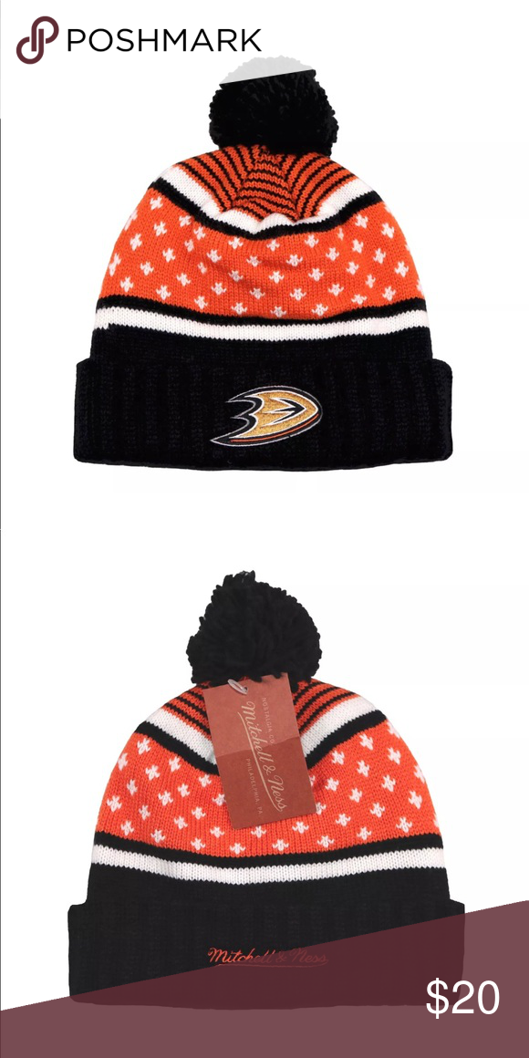 508acdc364f Mitchell   Ness Anaheim Ducks Highlands Pom Beanie Mitchell   Ness Anaheim  Ducks Highlands Cuffed Pom