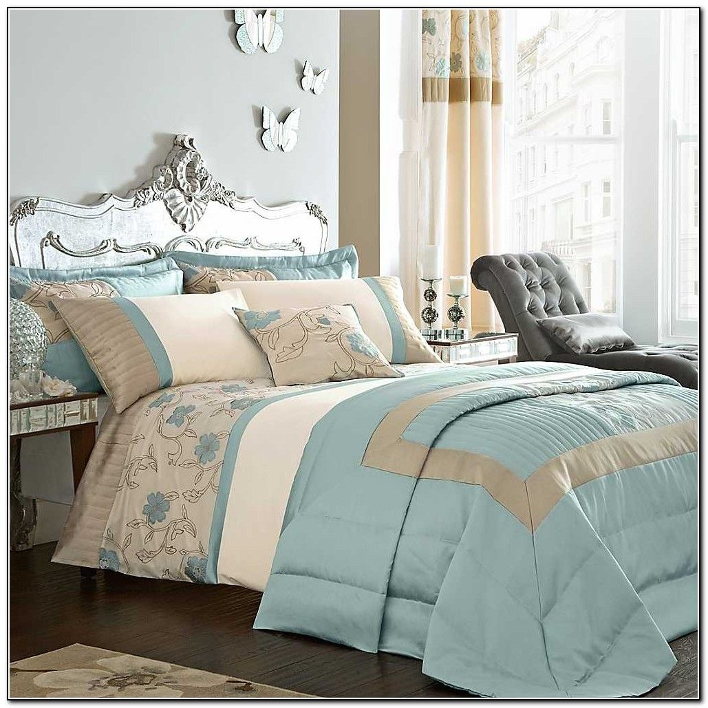 Master Bedroom With Duck Egg Blue And Brown Bedding Also Butterfly