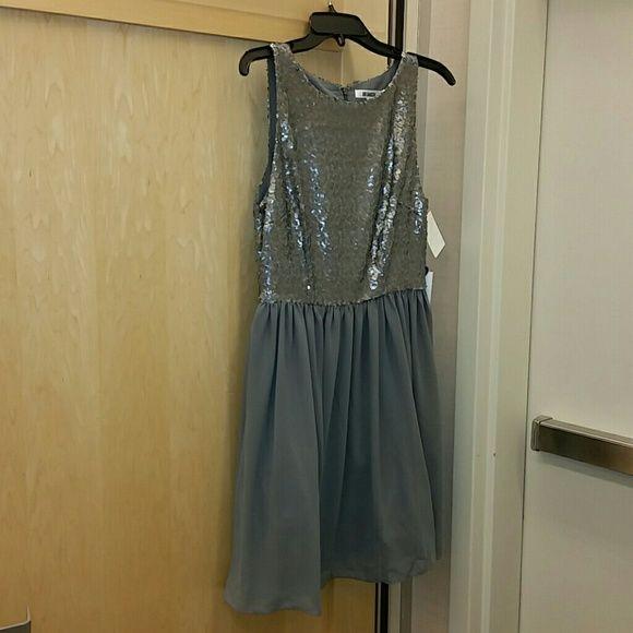 Nwt BB Dakota sliver dress NWT silver sequined dress.  Definite stunner!  Size 10. Fits more like an 8. BB Dakota Dresses Midi