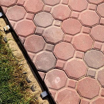 Front Walkway With These Red Bricks