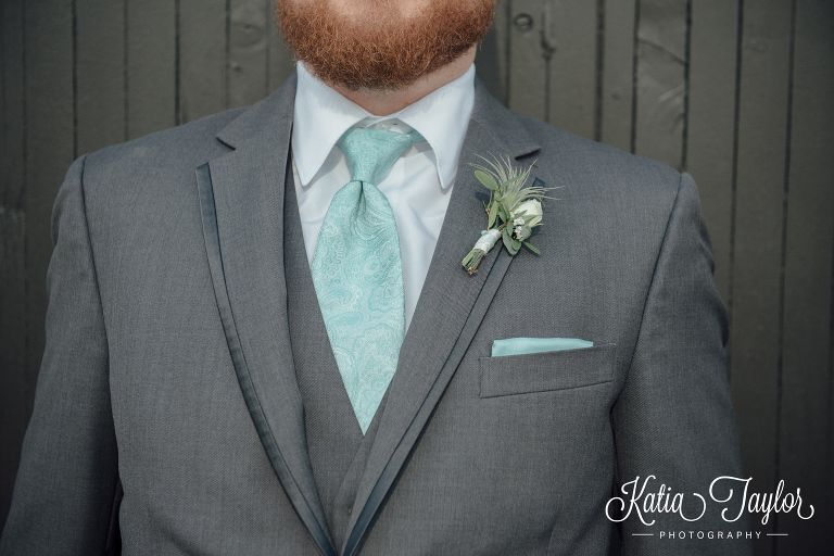 Groom in grey suit with turquoise tie and pocket square.   Katia ...