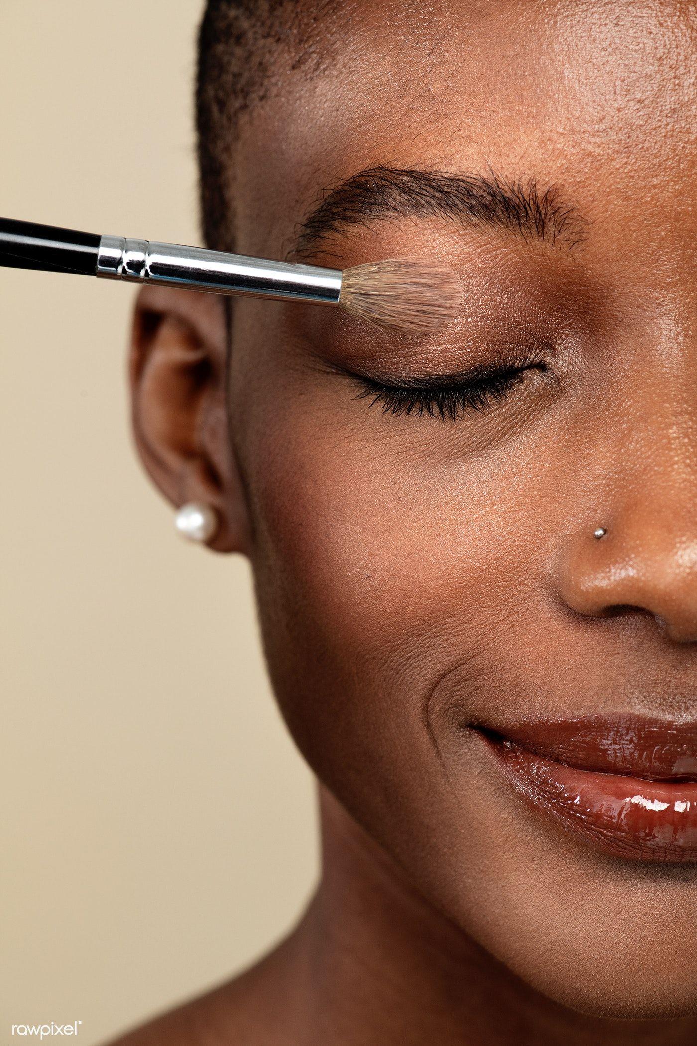 Download premium image of Makeup artist applying eye