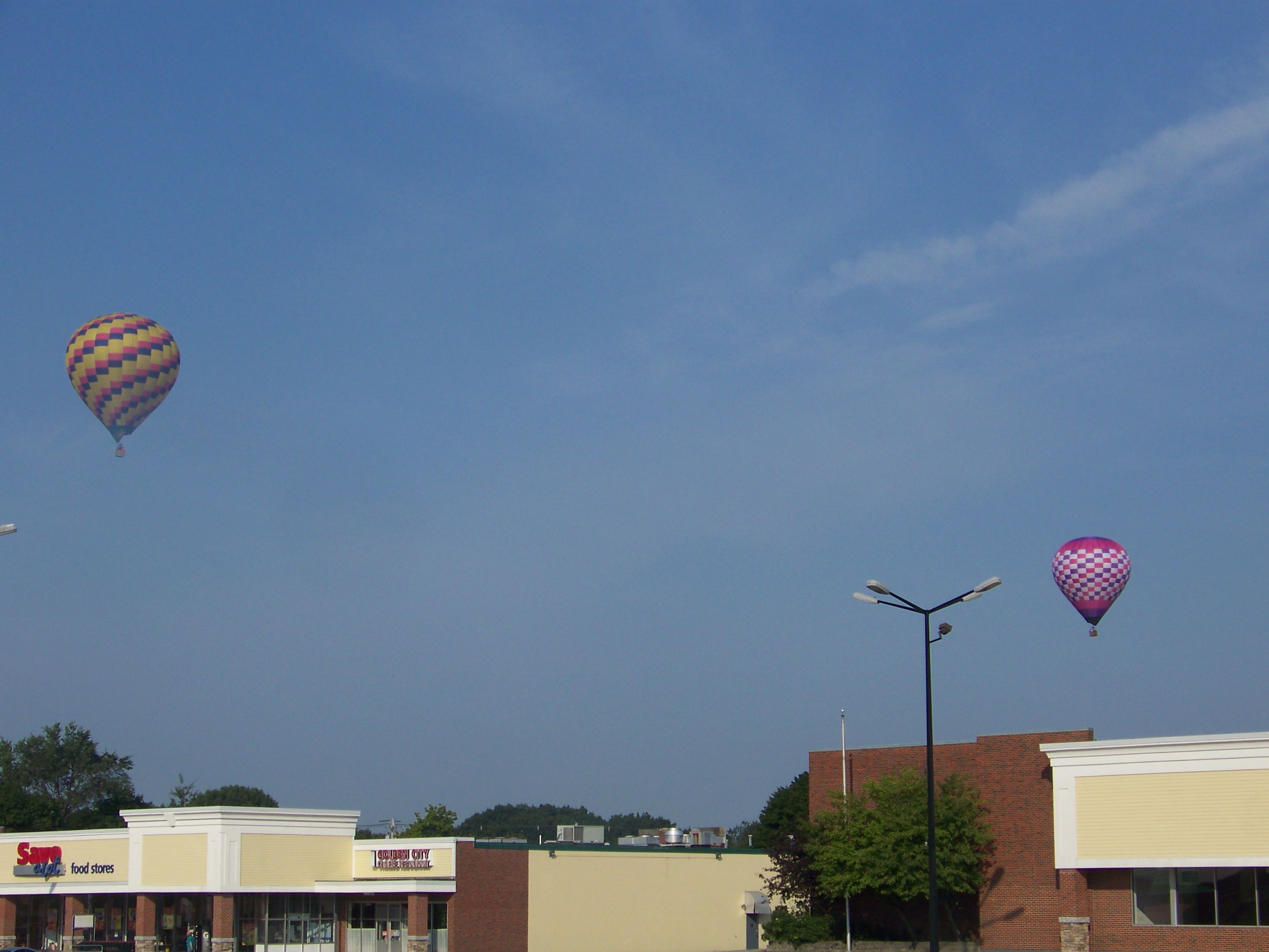 Hot Air Balloons float around over the city of Lewiston